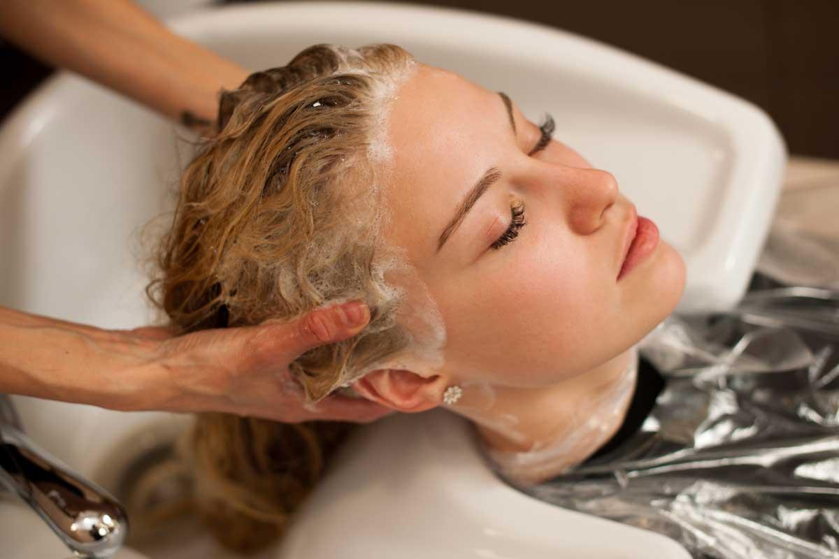 woman receiving shampoo treatment at a hair salon